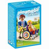 Cumpara ieftin Playmobil City Life, Copil in carucior cu rotile