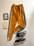 Cumpara ieftin Pantaloni dama casual galbeni tip jogger cu dungi laterale negre si imprimeu YES