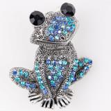 Cumpara ieftin Brosa metalica broscuta argintie cu pietricele albastre