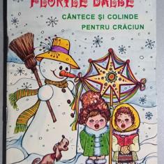 Florile dalbe  Cantece si colinde pentru Craciun - l. rom., engl., franc., germ.