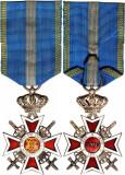Ordinul - Coroana Romaniei, in grad de Cavaler, militar pe timp de razboi.