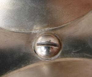 Tava din alama argintata marcata PRIMA NS avand maner din ebonita