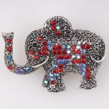 Cumpara ieftin Brosa metalica elefant cu pietricele rosii