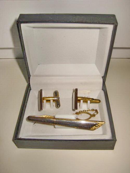 5631-Set Ac Cravata+Butoni in metal aurit cu fatete argintii model Art Deco.