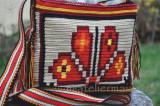 Cumpara ieftin Geanta crosetata manual  ornamentata cu motivul popular din Crisana soare floare