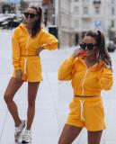 Cumpara ieftin Compleu dama ieftin galben compus din pantaloni scurti elastici si hanorac cu fermoar si gluga
