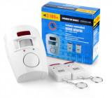 Cumpara ieftin Alarma de securitate wireless cu senzor de miscare si doua telecomenzi