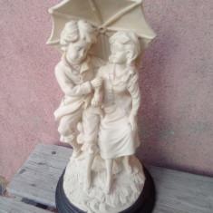 Statueta semnata/