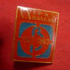 2 Insigne IPRS Baneasa la 10ani- 1972 si 20 Ani-1982,h=2,5cm ,metal si email