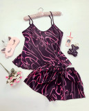 Cumpara ieftin Pijama dama ieftina primavara-vara negru cu roz din satin lucios cu imprimeu linii serpuite
