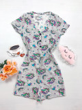 Cumpara ieftin Pijama dama scurta tip salopeta gri cu nasturi si imprimeu Unicorn