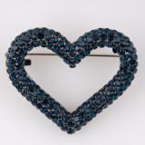 Brosa metalica inima acoperita cu pietre albastre