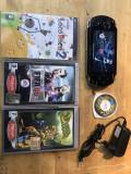 Consola sony psp-1004 + 4 jocuri + incarcator + card sony